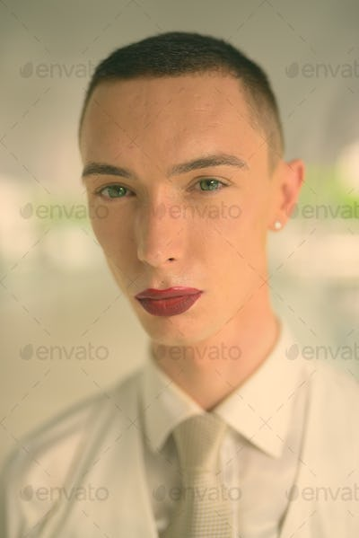 Young handsome androgynous businessman exploring the city of Bangkok, Thailand