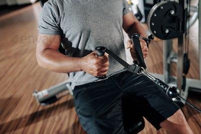 Man exercising in row machine