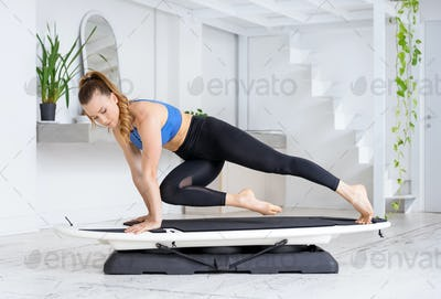 Athlete doing a high plank cross spider exercise