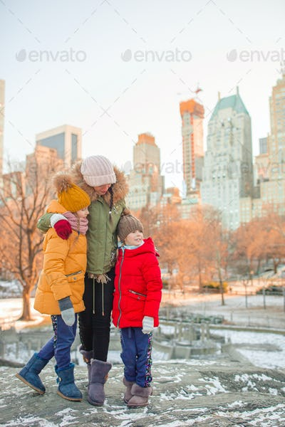 Family of mother and kids in Central Park during their vacation in New York City