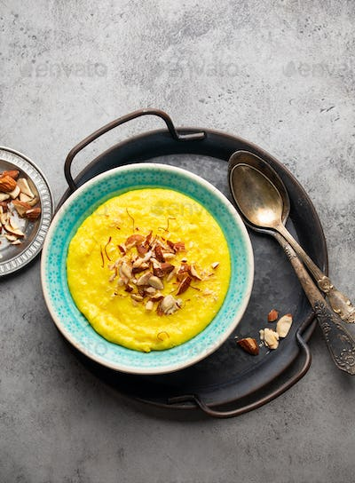 Traditional Indian dish Kheer, sweet rice milk pudding with almonds and saffron