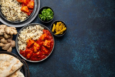 Chicken tikka masala dish with rice