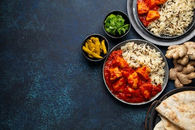 Chicken tomato curry, traditional Indian meal, free space for text
