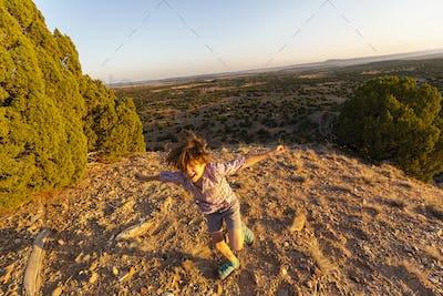 Young boy running in Galisteo Basin, Santa Fe, NM.
