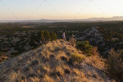Young boy overlooking Galisteo Basin, Santa Fe, NM.