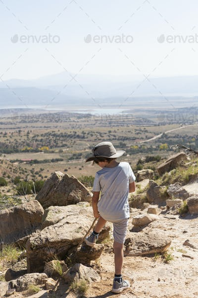 Young boy hiking on Chimney Rock trail, through a protected canyon landscape