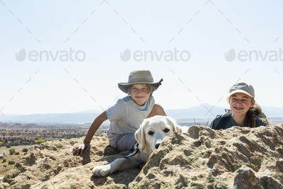 young boy and his teen sister with their dog