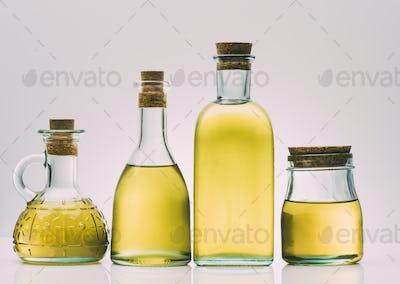 olive oil bottles on pink background