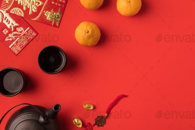 top view of oriental decorations, greeting cards with calligraphy and ceramic tea set isolated on