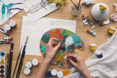 Cropped image of artist mixing acrylic paints