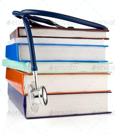 books and stethoscope isolated on white background