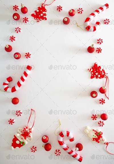Christmas baubles and candies flat lay against white background, xmas frame, card template