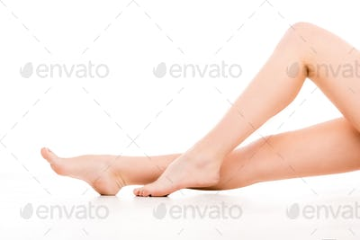 low section of barefoot perfect legs, isolated on white