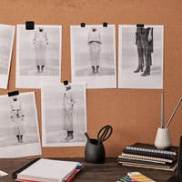 Color palette and photos on carton board in front of table with other supplies