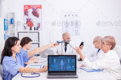 Group of medical staff discussing