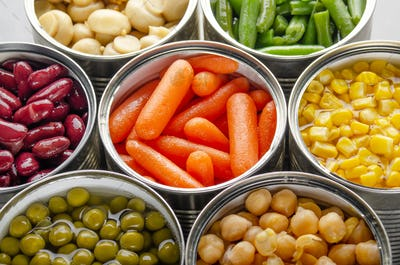 Canned vegetables in opened tin cans