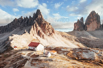 Dolomite mountain of Paternkofel with little fog on top and clouds