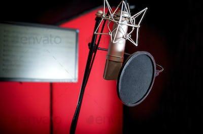 Professional microphone recording voice in music studio