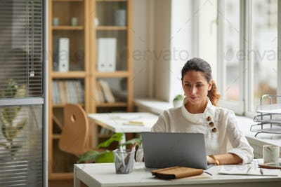 Successful Female Professional using Laptop at Home Office