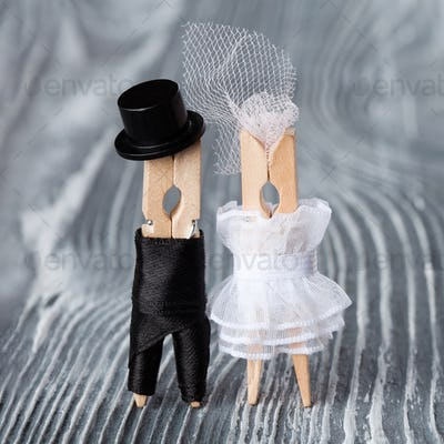 Wedding invitation card. Clothespins toys