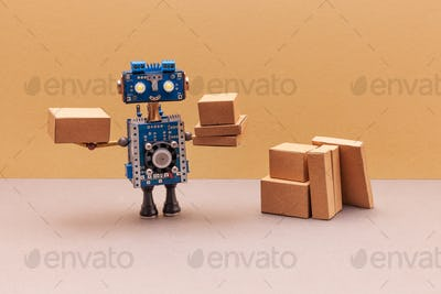 Robot packer storekeeper sorts parcels. Automation service warehousing, groceries and shipments.