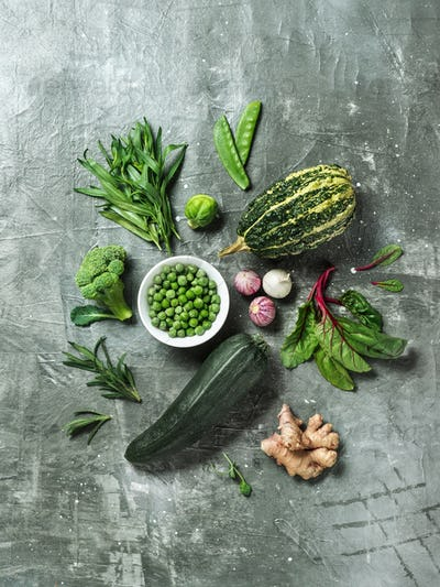 Greens and green vegetables on gray background