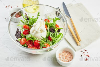 Burrata, Italian fresh cheese with tomato, arugula and red basil salad