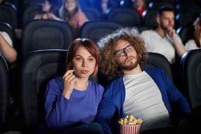Caucasian couple enjoying time in cinema