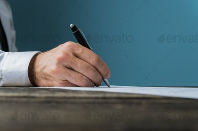 Businessman or lawyer signing a document