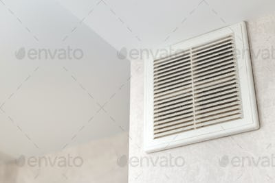 Dirty ventilation grille in the kitchen on the wall. Communication in the kitchen.