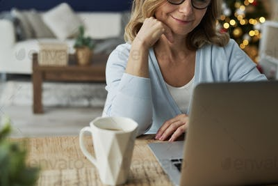 Close up of mature woman having video conference during Christmas