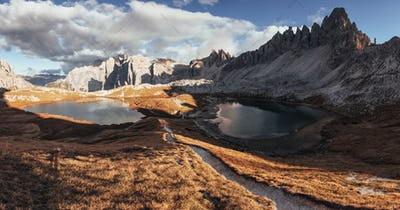 Valley with lakes in the majestic dolomite mountains at sunny day. Panoramic photo