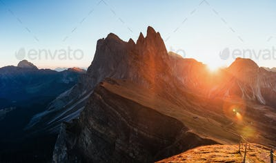 Outstanding landscape of the majestic Seceda dolomite mountains at daytime. Panoramic photo