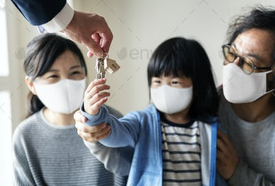 Real estate agent and customer in face mask looking at a new project
