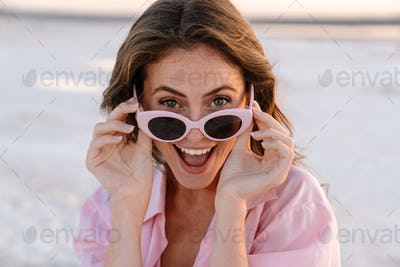 Surprised shocked young girl in sunglasses