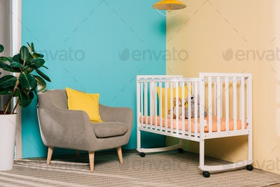 interior of retro styled bright child room with wooden cot