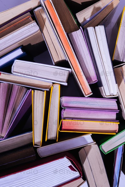top view of scattered stack of books on table