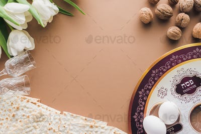 top view of traditional jewish plate and matza on beige table, Passover Haggadah concept