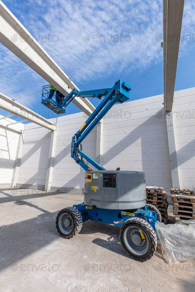 Warehouse construction site with industrial vehicle