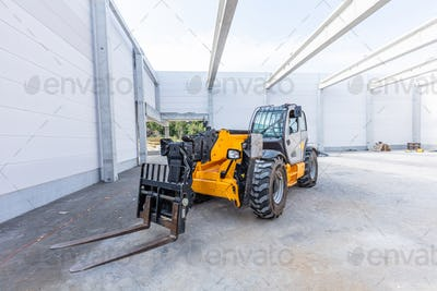 Industrial warehouse construction. Rotating telehandler vehicle
