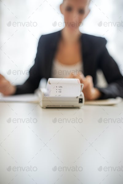 Young female accountant working on annual report
