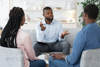 Family Psychotherapy. African American Couple Listening To Counselor's Advices During Therapy