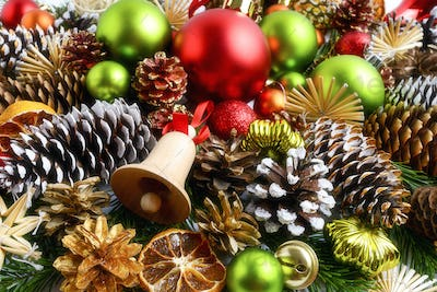 Christmas background with multicolored ornaments and snowy cones