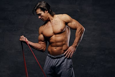 A man  doing biceps workouts with fitness trx straps.