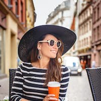 Beautiful young lady in big summer hat
