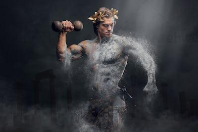 Crushing stone human athlete holds the dumbbel.