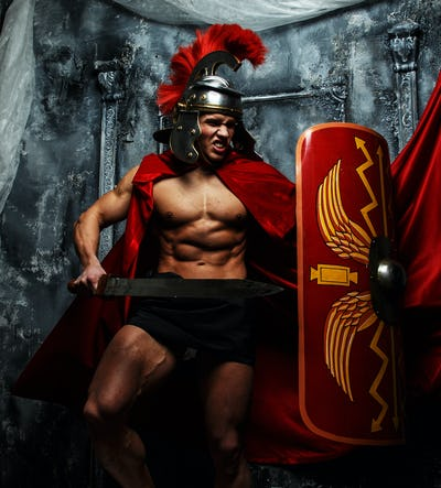 Muscular warrior attacks his enemies