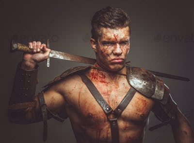 Bloody gladiator in armor.