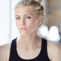 Blond woman in black shirt.