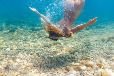 Snorkeling underwater in the tropical sea